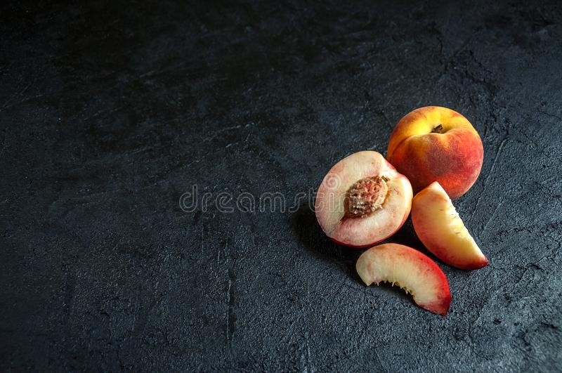 Fresh Juicy Peach and Nectarine on Dark Background. Minimalism Concept. Copy Spase For Your Text royalty free stock image