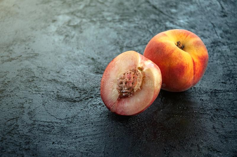 Fresh Juicy Peach and Nectarine on Dark Background. Minimalism Concept. Copy Spase For Your Text stock photography