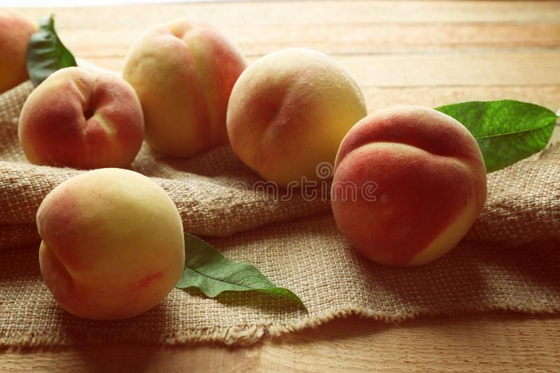 Fresh juicy peaches on bagging stock photography
