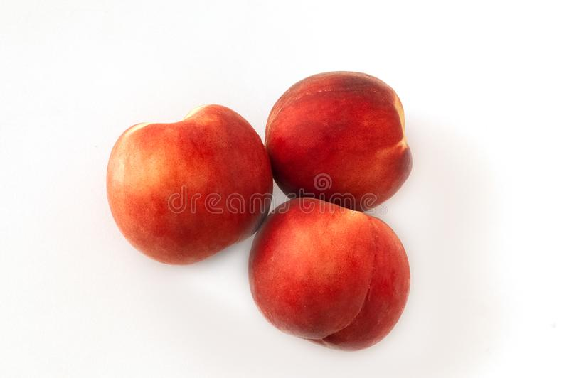 Fresh juicy peaches fruits and ripe apricots isolated on white background. Summer fruit concept. Close-up royalty free stock image