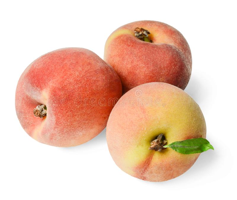 Fresh juicy peaches isolated on white. Bright saturated colors. stock photos