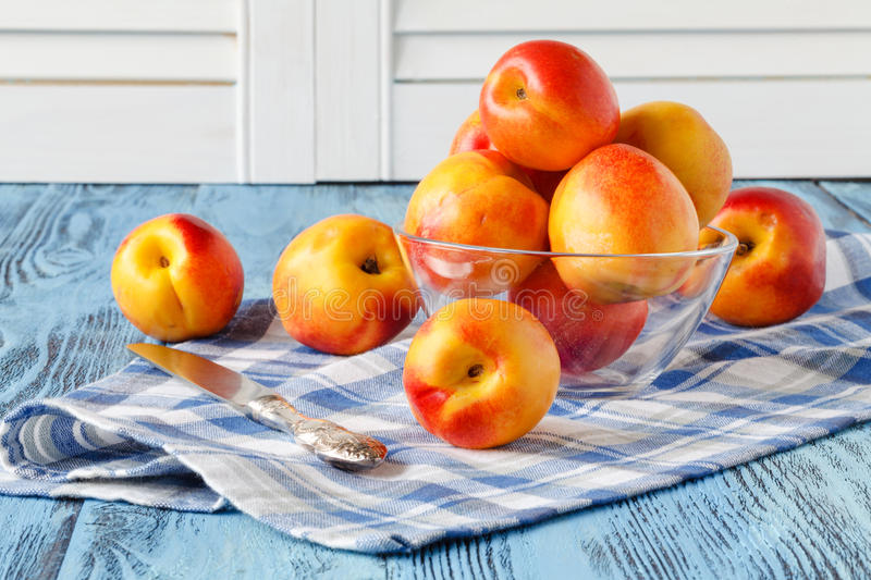 Fresh juicy peaches on napkin and turquoise wooden background royalty free stock photo