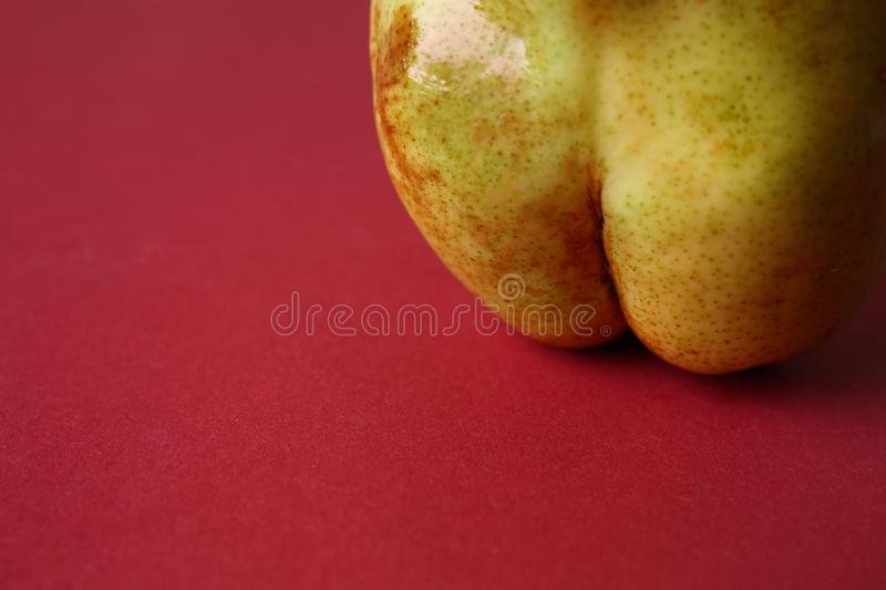 Fresh juicy pear on color background, closeup. Erotic concept stock photo