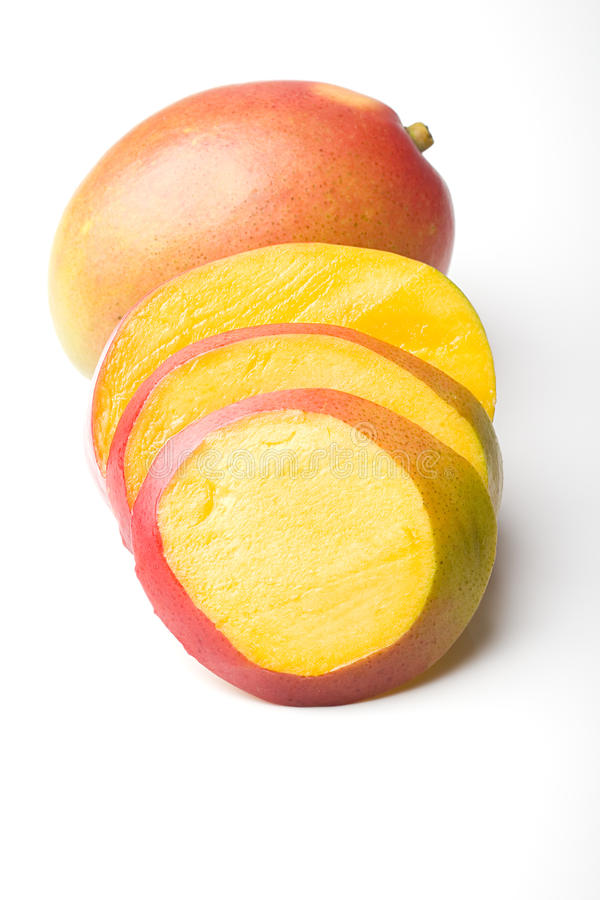 Fresh juicy ripe mango tropical fruit sliced royalty free stock photo