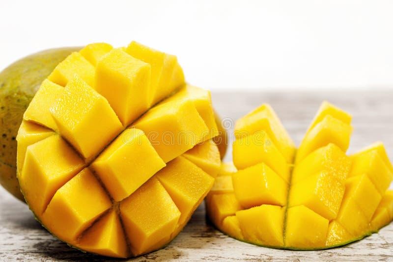 Fresh juicy yellow Thai chopped mango on the table stock photo