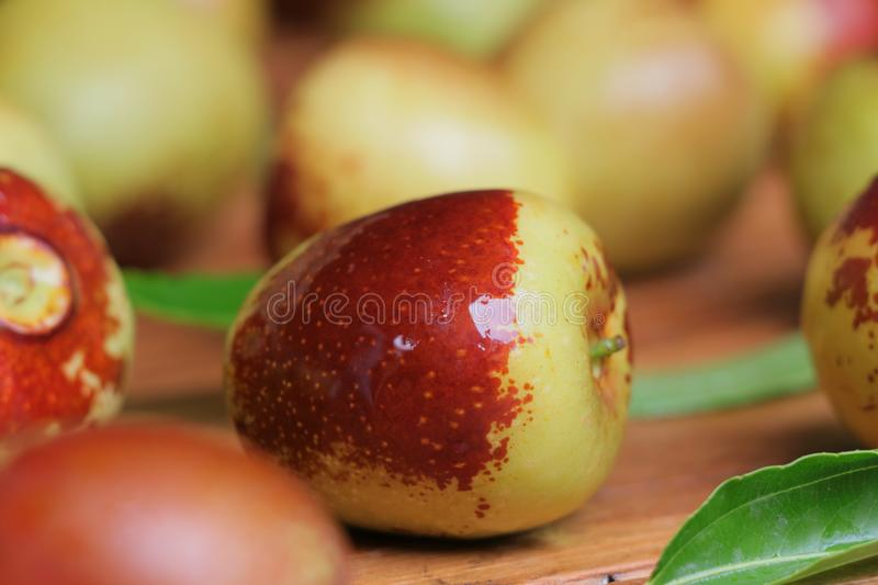 Fresh jujubes fruit on wooden table. stock images