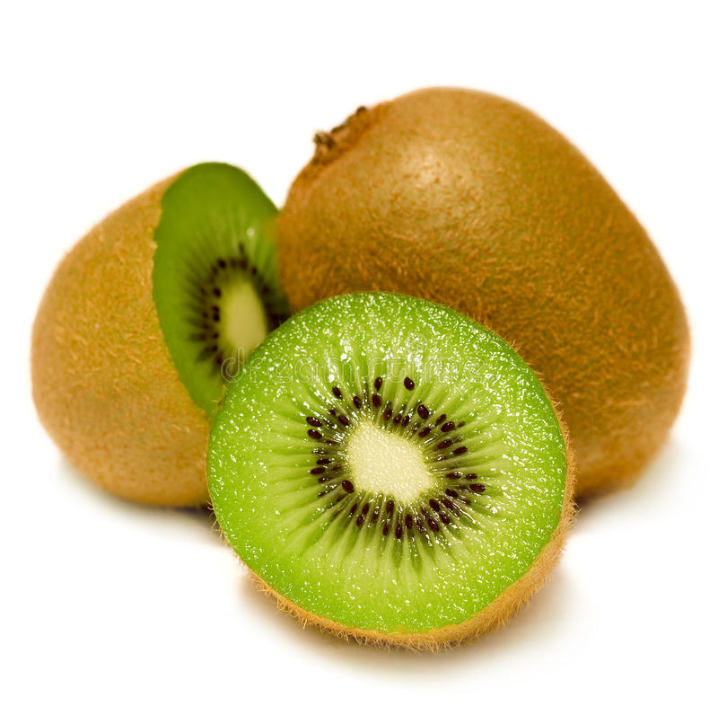 Fresh Kiwi. A fresh kiwi fruit cut in two pieces on a white background royalty free stock images