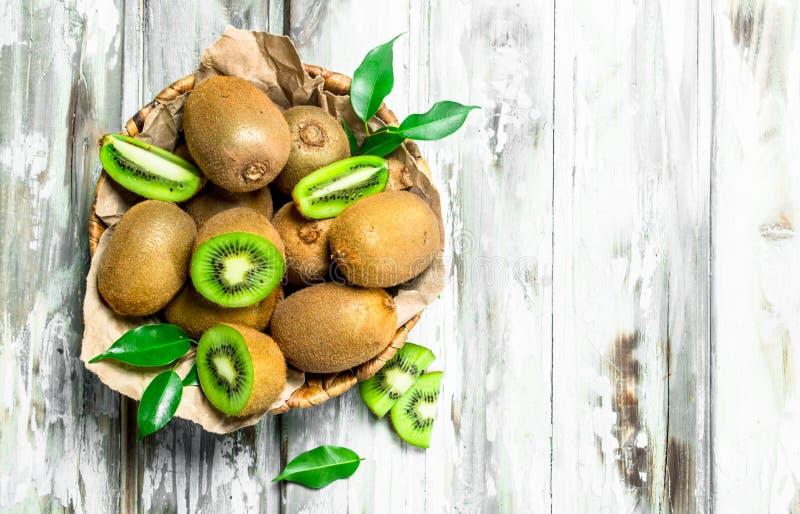Fresh kiwi in the basket stock images