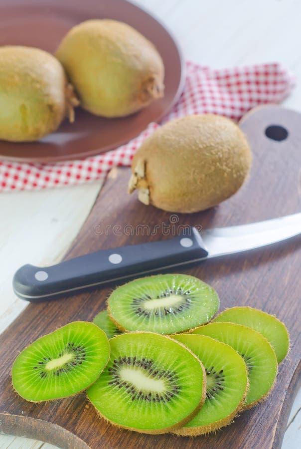 Fresh kiwi. On the board royalty free stock photos