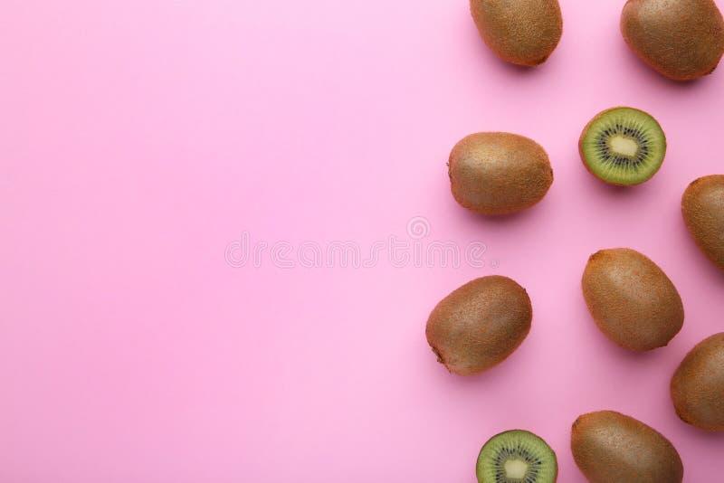 Fresh kiwi fruit on pink wooden background.  stock photography