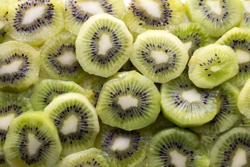 Fresh Kiwi Fruit Slices. Fresh organic Kiwi Fruit Slices arranged showing the pips & structure royalty free stock photos