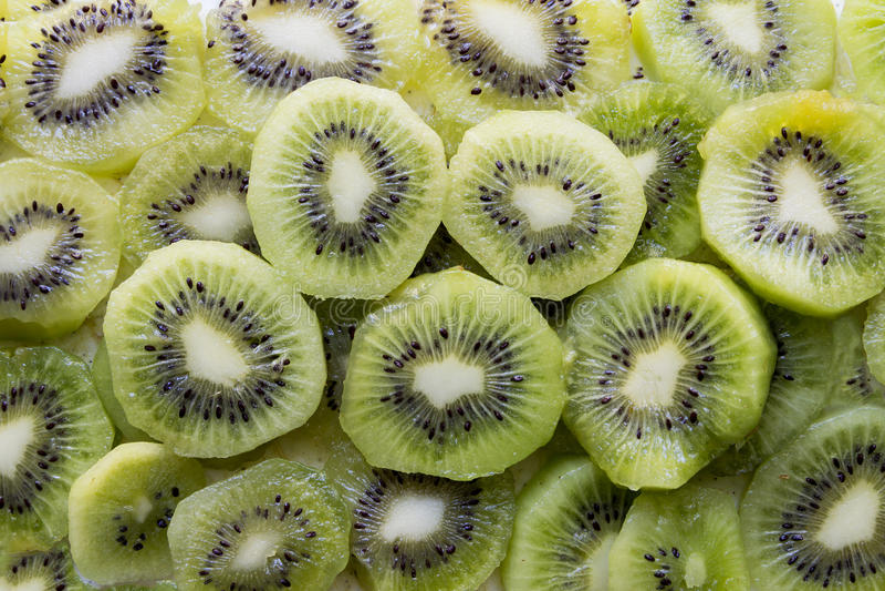 Fresh Kiwi Fruit Slices. Fresh organic Kiwi Fruit Slices arranged showing the pips & structure stock image