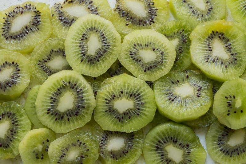 Fresh Kiwi Fruit Slices. Fresh organic Kiwi Fruit Slices arranged showing the pips & structure stock images