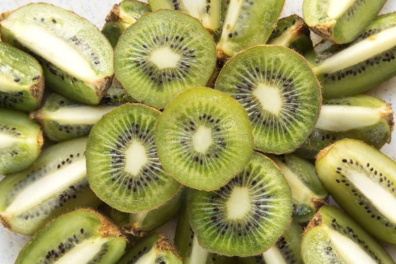 Fresh Kiwi Fruit Slices. Fresh organic Kiwi Fruit Slices arranged showing the pips & structure stock photo