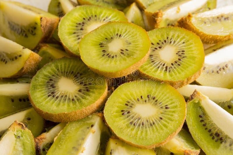 Fresh Kiwi Fruit Slices. Fresh organic Kiwi Fruit Slices arranged showing the pips & structure royalty free stock photography