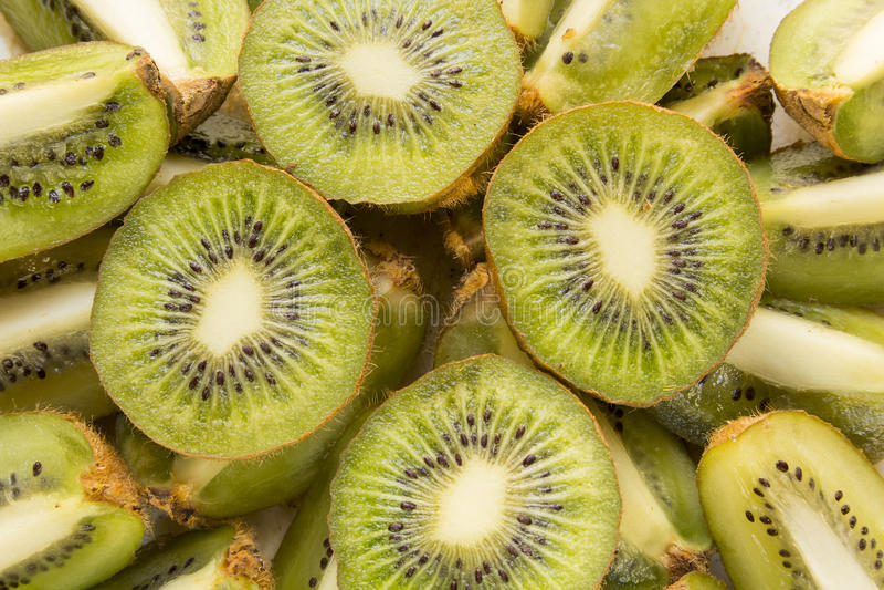 Fresh Kiwi Fruit Slices. Fresh organic Kiwi Fruit Slices arranged showing the pips & structure royalty free stock image
