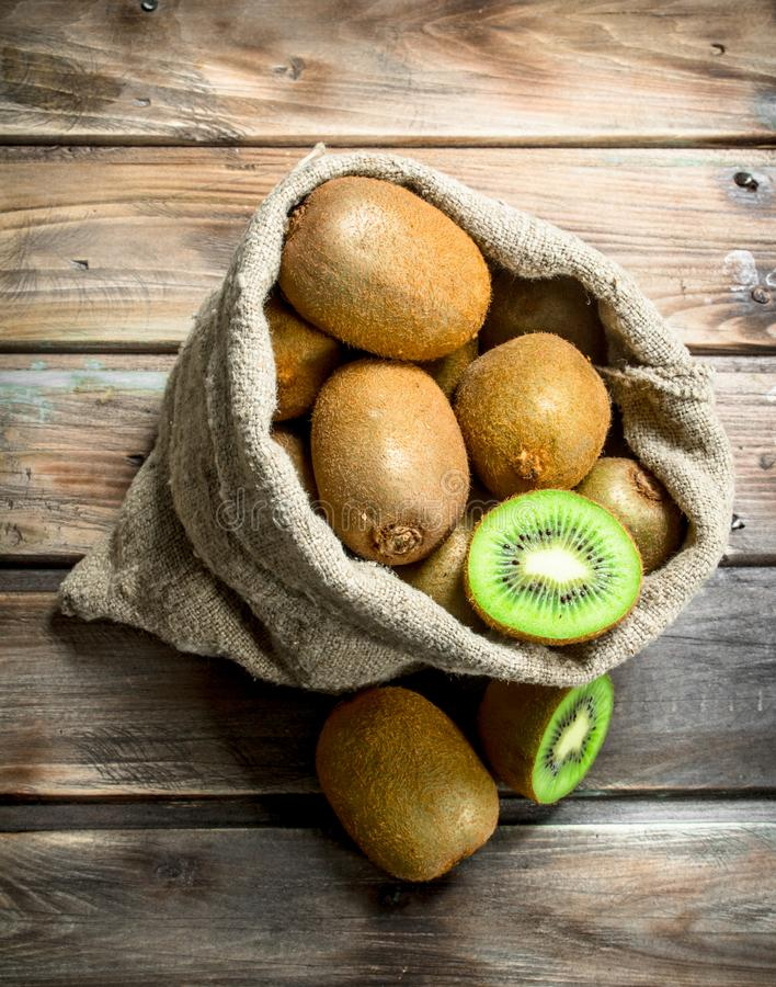 Fresh kiwi in an sack stock images