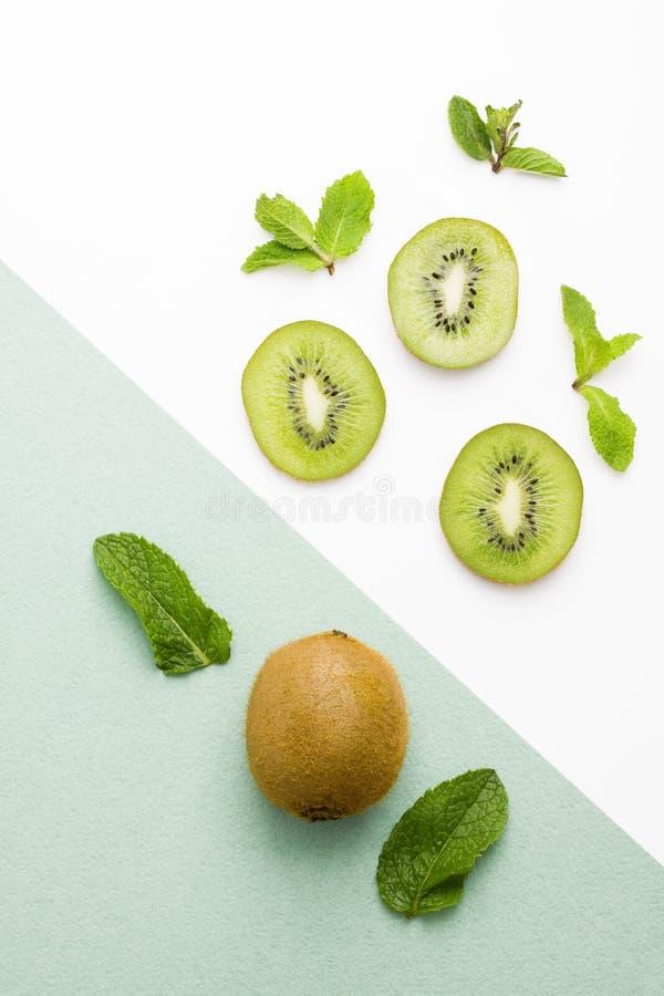 Free Fresh Kiwi Whole Fruit Slices Mint On Green White Background Stock Image - 118188561