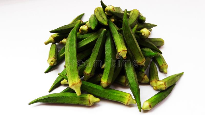 Fresh ladyfinger isolated on white background closeup image. Vegetable, food, okra, green, organic, nobody, ladies, soul, crispy, american, raw, container royalty free stock photo