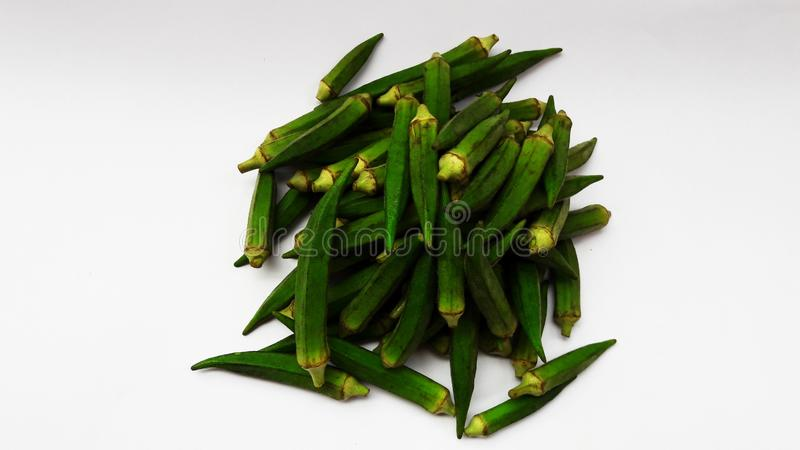 Fresh ladyfinger isolated on white background closeup image. Vegetable, food, okra, green, organic, nobody, ladies, soul, crispy, american, raw, container stock photo