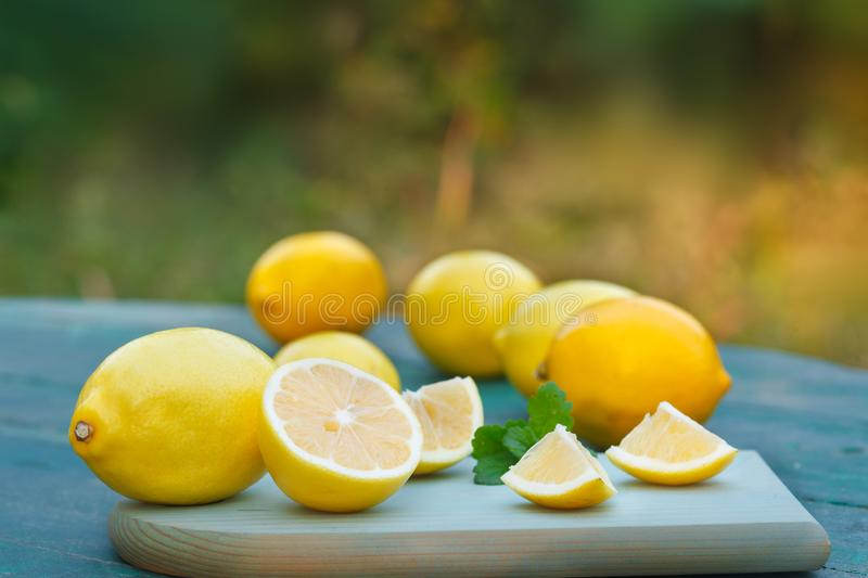 Fresh lemon on a blue table stock photos