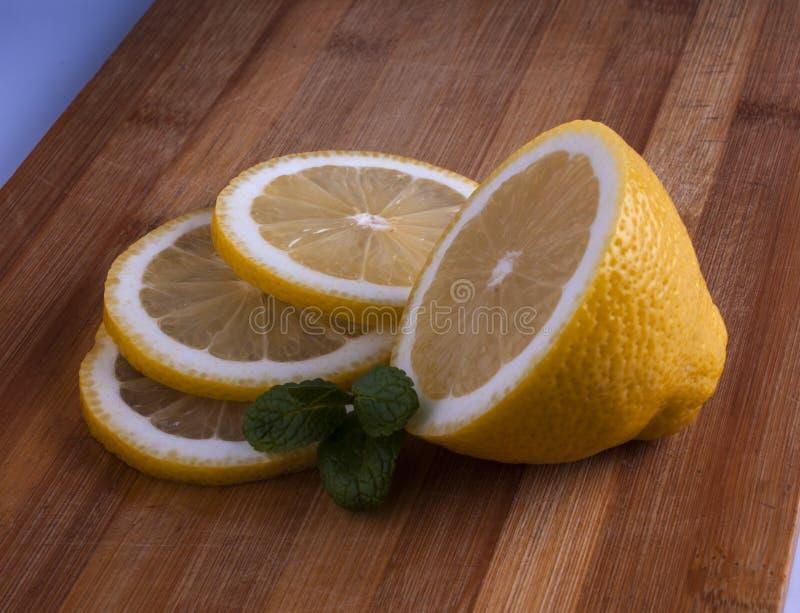 Fresh lemon cut on bamboo board royalty free stock image