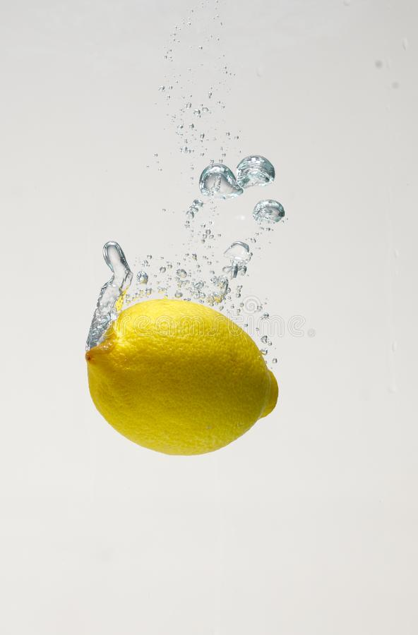 Fresh lemon drop on water with babble stock images