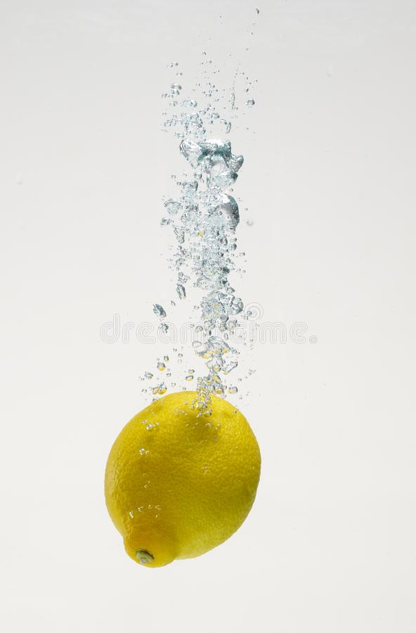 Fresh lemon drop on water with babble royalty free stock photography