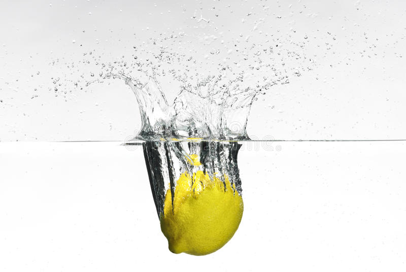 Fresh Lemon Dropped Into Water Stock Photos