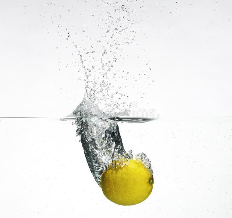 Download Fresh Lemon Dropped Into Water Stock Photo - Image of ripe, macro: 10722488