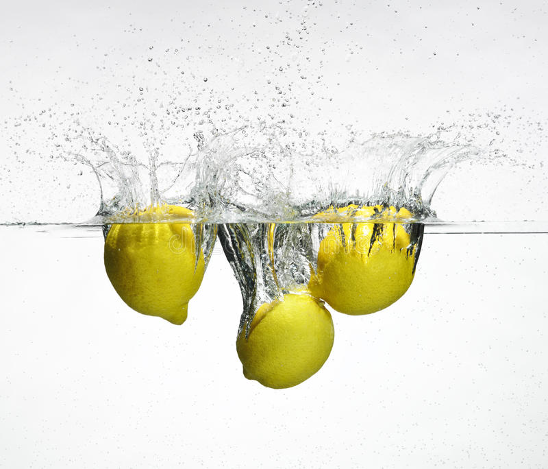 Download Fresh Lemon Dropped Into Water Stock Image - Image: 10722513
