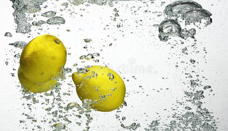 Download Fresh Lemon Dropped Into Water Stock Photo - Image: 10722716