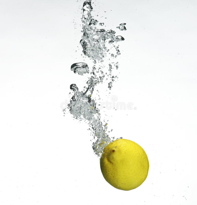Fresh Lemon Dropped Into Water Royalty Free Stock Photo