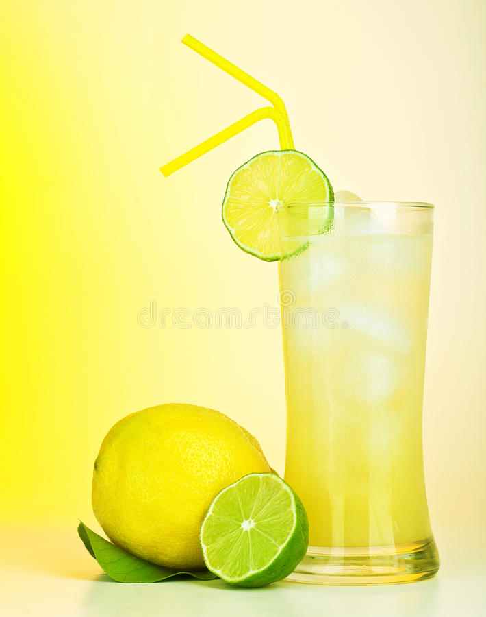 Fresh lemon juice. Tasty cold lime drink, healthy fruits and icy beverage, sweet refreshing lemonade, tropical citrus cocktail, full glass of alcohol isolated stock images