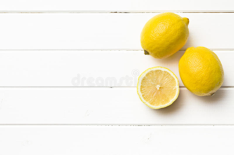 Fresh lemon on kitchen table royalty free stock photos
