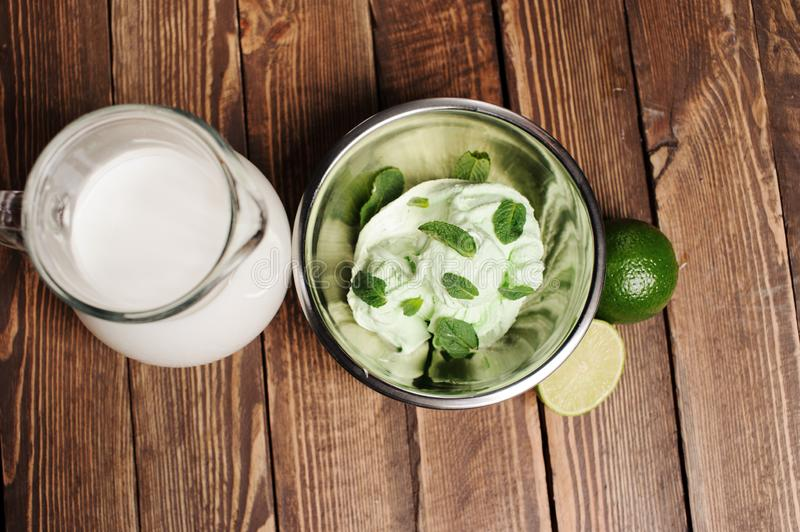 Fresh lemon and lime homemade ice cream in a white cup of milk stock photo