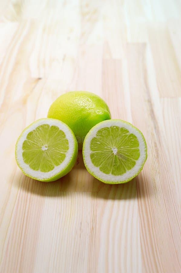 3816229 fresh lemon over pinewood table stock photos