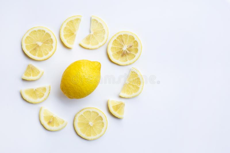 Fresh lemon with slices on white background. Top view stock photography