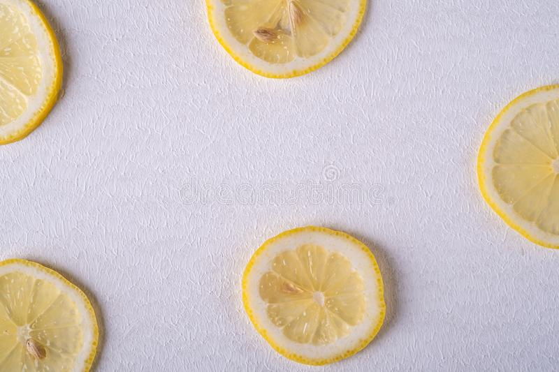 Fresh lemon slices on white gray background, texture, top view, flat lay stock photography