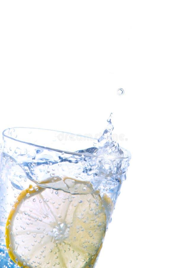 Fresh lemon in sparkling water royalty free stock photos