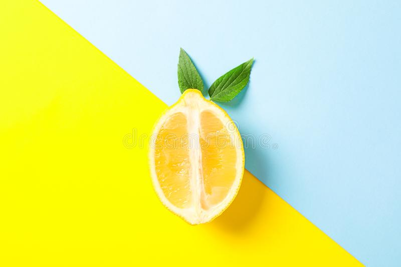 Fresh lemon on two tone background. Space for text royalty free stock images