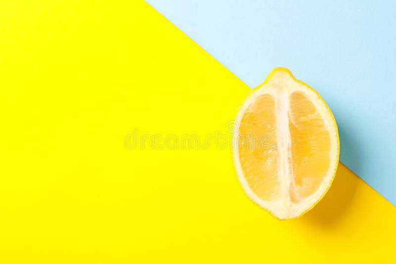 Fresh lemon on two tone background. Space for text stock photo