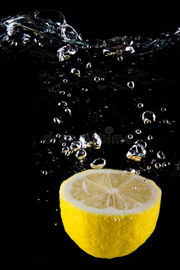 Fresh lemon in the water royalty free stock photos