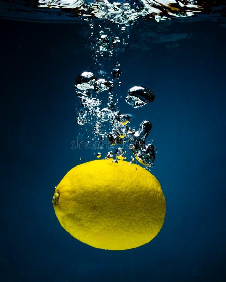 Fresh lemon in water stock photos