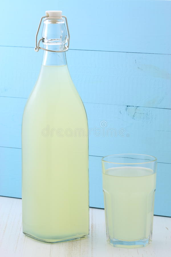 Fresh lemonade. Delicious and nutritious, organic lemonade on vintage bottle and glass stock photo
