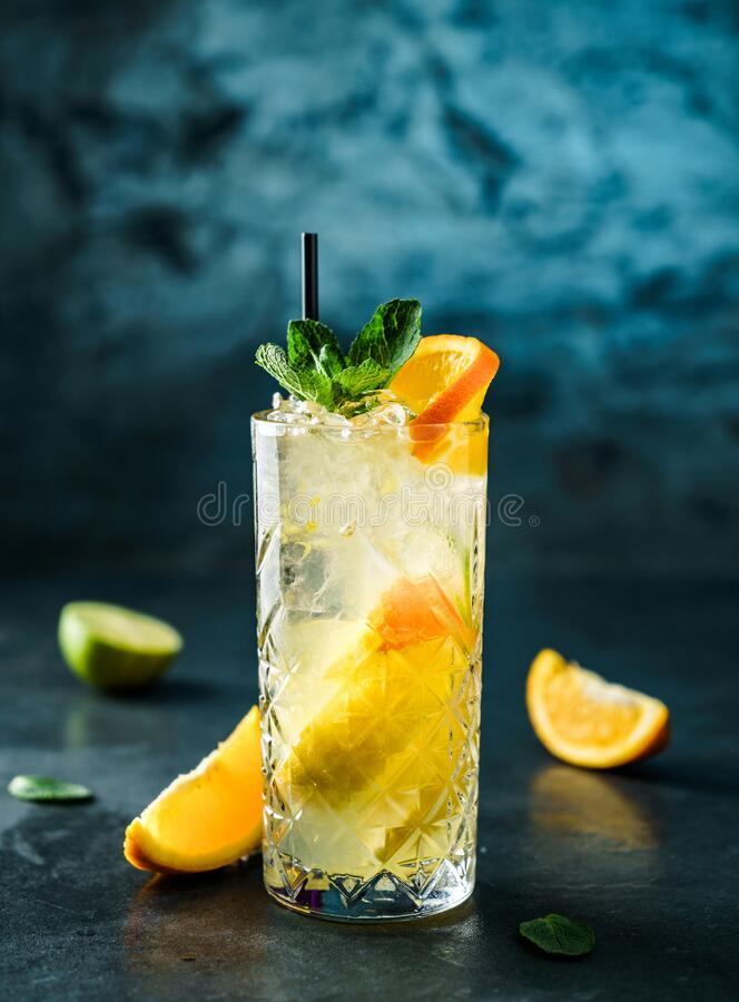 Fresh lemonade with mint, ginger, orange and ice in glass jar on the dark blue background. Summer cold drink and cocktail. Fresh lemonade with mint, ginger royalty free stock photos