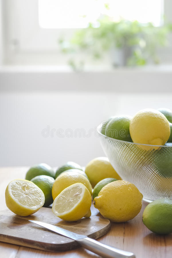 Fresh Lemons limes on wood board royalty free stock photo
