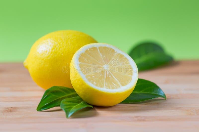 Fresh lemons on a table royalty free stock photo