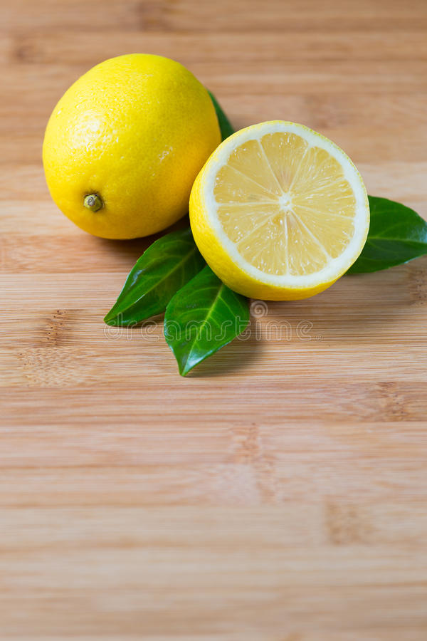 Fresh lemons on a table stock images