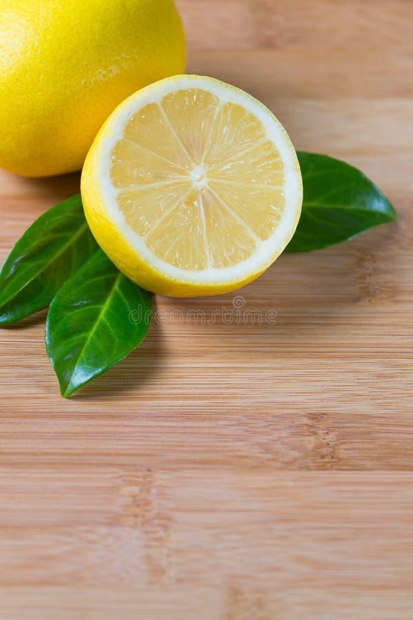 Fresh lemons on a table stock photo